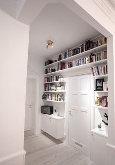 Space saving storage. Love how this keeps the floor level tidy and draws your view upwards. This could work in a small study or shields bedroom also!