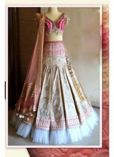 Pink and beige heavy embroidered double flare lehenga Pink and beige net brocade heavy embroidered Golden thread and stone work on Comes with matching Can be stitched upto size 42 inches Lehenga Style Saree, Indian Lehenga, Bridal Lehenga Choli, Indian Wedding Outfits, Indian Outfits, Dress Indian Style, Indian Wear, Sarees Online India, Indian Clothes Online