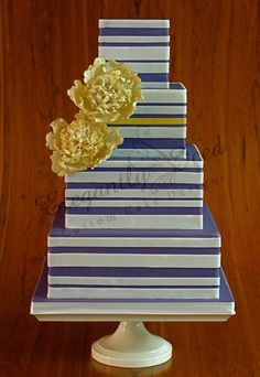 blue and white stripes + gold flowers, elegantly iced.