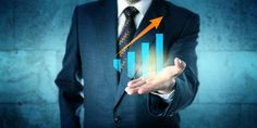 Save Download Preview Manager in blue business suit is offering a virtual growth chart with upward soaring trend arrow in the upward facing open palm of his left hand.