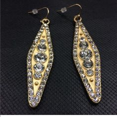 """Gold Diamond Shaped Earrings NWOT-Nickel free. Approximately 2 1/2"""" long. Please feel free to ask questions. Price is FIRM, unless Bundled No: Holds, Trades, or PP! Thank you! Fashion Jewelry Jewelry Earrings"""