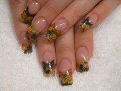 Halloween designed french nails - the polish is great, but the squared off nail shape is unnatural and gross.