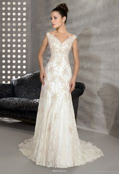 This one almost looks like it has snowflakes on it. I like that for a Dec wedding. *But I wouldn't want Actual snowflake shapes*