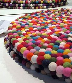 pinocchio rug by HAY . felted wool balls strung together...so fun