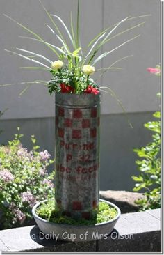Chicken feeder~ This entire post has some great junk planting ideas!