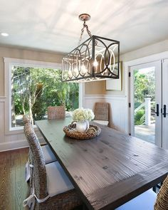 Learn the appropriate length for hanging a dining room chandelier over a dining room table.