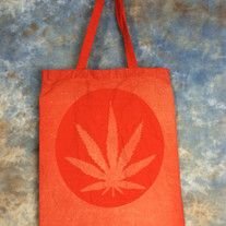 Bleach Dyed red bag with a Hippie Pot Leaf design on it. Design is only on ONE side. Perfect for festivals, concerts, conventions, as a reusable shopping bag or as a purse.  Red 100% cotton canvas promo bag (thinner than reg. canvas bags from the craft store), Self fabric handles, L 14 inches x...
