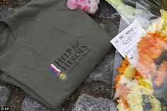 London May 22nd 2013 .Honour: A Help for Heroes t-shirt which was left at the scene today. The soldier was wearing one of the charitys tops when he was brutally murdered