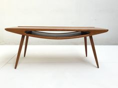 Danish 'Smiley' Teak and Oak Coffee Table in the Style of Johannes Andersen | From a unique collection of antique and modern coffee and cocktail tables at https://www.1stdibs.com/furniture/tables/coffee-tables-cocktail-tables/