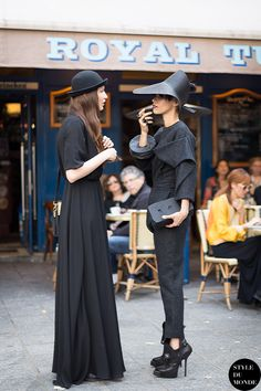blackout brilliance x 2. #LilyGatins & #MadalinaNemes (#offduty) showing us how it's done in Paris.