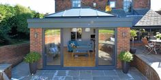 With these REAL aluminium sliding doors and lantern in your flat roof extension or garden room, you can open up your living space to create a modern and contemporary feel. House Extension Plans, House Extension Design, Roof Extension, Glass Extension, Orangery Extension Kitchen, Orangerie Extension, Conservatory Extension, Kitchen Extension Roof Ideas, Kitchen Extension Exterior