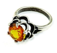 """Optimistic - """"Two layers of scalloped antique silver frame an amber-hued, diamond-cut glass gem on this eye-catching ring."""" www.jewelrystar.mialisia.com"""