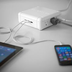 The Powerqube is a multi-port USB Charger and power strip that allows you to simultaneously charge up to nine devices.