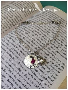 Here's a Mother's anklet I made for a friend. She asked to have her daughter's name on it, her birthstone and a lady bug charm! Have one created for you or a special friend! Contact the Pretty Chicky Boutique today!#metal Stamped jewelry http://www.facebook.com/PrettyChickyBoutique