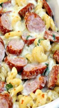 Great for a sports banquet. Spicy Smoked Sausage Alfredo Bake (Sausage Recipes For Dinner) Smoked Sausage Recipes, Pork Recipes, Cooking Recipes, Healthy Recipes, Smoked Sausages, Polish Sausage Recipes, Recipes With Farmer Sausage, Kilbasa Sausage Recipes, Snacks