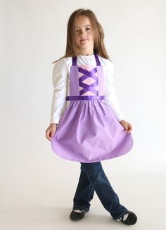 Get the free PDF sewing pattern for this Rapunzel Tangled princess dress up apron. Handmade Christmas gift for a girl. Princess Aprons, Princess Dress Up, Tangled Princess, Princess Costumes, Disney Princess, Sewing Patterns Free, Free Sewing, Dress Patterns, Apron Patterns