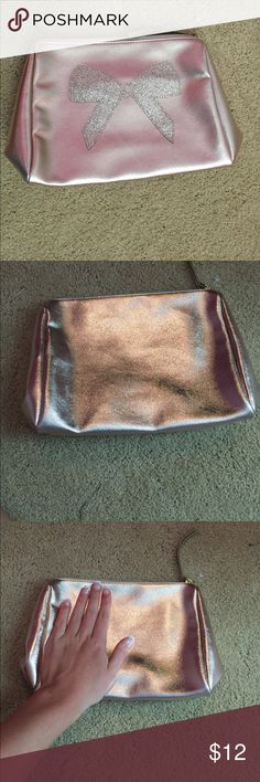 Glitter Makeup Bag With BOW!! Never been used! So so cute! Outside is a rose gold shimmer material and then a gold glitter bow. From Bath and Body Works. Forever 21 Bags Cosmetic Bags & Cases