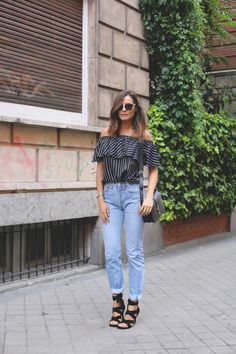 Reinvent high-waist, mom jeans with @stylecaster's street style round-up | 'Lady Addict' in striped, ruffle off-the-shoulder blouse, black sandals, light-wash denim