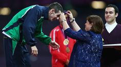 Paralympics 2012: Michael McKillop receives his gold medal from his mother.