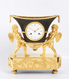 A French Empire mantel clock, putti with flower urn, circa 1800