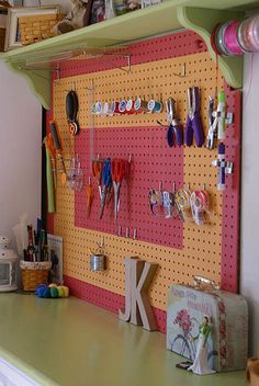 Peg board and shelf to help organize crafts tools.
