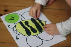 Put a number of play dough stripes on the bee