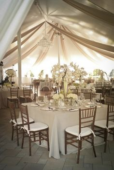 Love the ceiling treatment and the square tables!