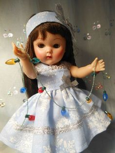 Dress, headband, and little light set for Ginny dolls.