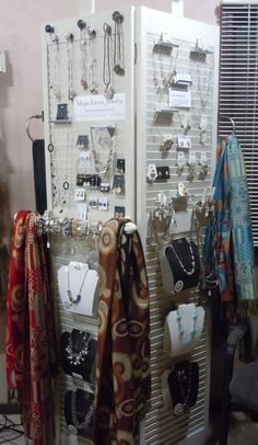 All items are from the Habitat for Humanity Restore. The shutters are wood $10, Paint $5.00, Old Drawer Pulls 4 for $1.00, Ring Dowels 10 for $1.00, Towel Holders mounted on either side for scarves $2, old window hanger for removable bracelet display $4.00, Jewlery Displays are made from poster board .50 and laminated at the School House. $1.50 per foot. extra board but on top of the display to use clip on lights but not needed in the salon because it has track lighting.  Thanks Michaels…