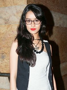 Shraddha Kapoor: Flaming red lipstick and thick-rimmed glasses — this combination has never looked hotter! This one's a sure-shot hit with the boys.