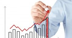 Businessman drawing a stock chart
