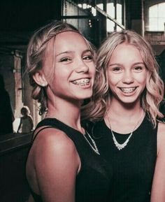 Lisa/lena] the twins walk around at the party, smiling and waving at their friends. they sit down bad talk to each other that's when you walk up.
