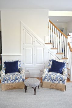 Bright walls help to make these blue ikat chairs stand out. A neutral wall does wonders for the decor in this family room.