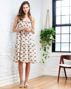 Spring 2016 Spaghetti strap tank dress with drop waist ruffle detail.Pull on with adjustable straps.Hand block printed with eyelet embroidery.Relaxed fit.Len...