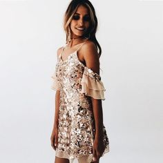 Pretty blush sequined party dress.