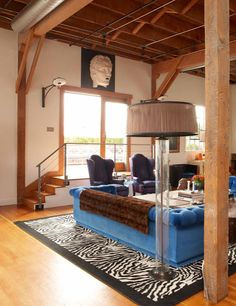 Rustic Style Loft and blue tufted velvet sofa