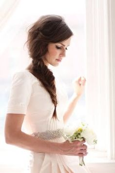 Simple and elegant. Be sure to check out daringdevoted.com for more wedding ideas. Fishtail braid wedding hair