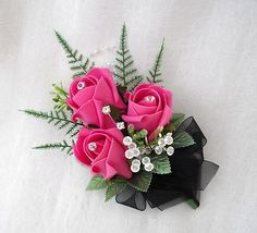 WEDDING FLOWERS - LADIES CORSAGE BUTTONHOLE IN HOT PINK ROSES WITH BLACK RIBBON