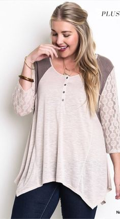 This 3/4 sleeve top features lace and buttons down the front. 65% Cotton, 35% Polyester.