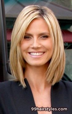 Medium length straight blonde with long layers side part and copper highlights hairstyle - Hairstyle Ideas
