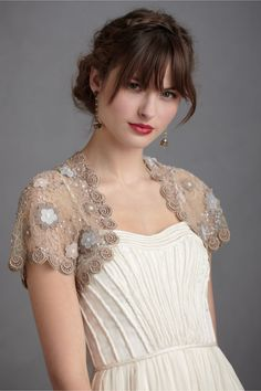 Pretty bolero from the front. 'Seaflower Bolero' BHLDN - with a blue motif.
