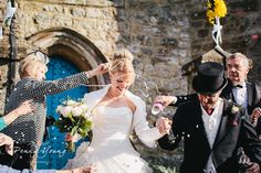 Confetti line. Spring wedding reception at Oakwood House in Maidstone Kent. Church wedding. Photography by Penny Young Photography.