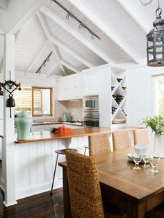 Rustic beach home. White with dark floors.