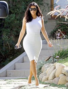 Kim Kardashian modeled a tight white tank and ivory pencil skirt for a photo shoot in Hollywood.