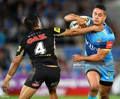Jarryd Hayne of the Titans has the ball stripped from him by Tyrone Peachey of…