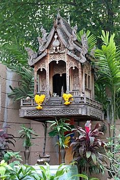 On our way to eat more pad thai, we found anther spirit House that reminded me of the house I would like to live in one day, only a smaller version, of course.