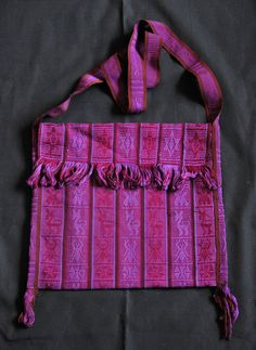 This hand woven cotton morral or traditional shoulder bag was made on Oaxaca's Pacific coast. I am uncertain about where the fabric was woven.  have purchased similar woven cloth in Huazolotitlan, but have seen similar designs in the weaving of San Juan Colorado as well as Pinotepa de Don Luis. These are all coastal Mixtec communities