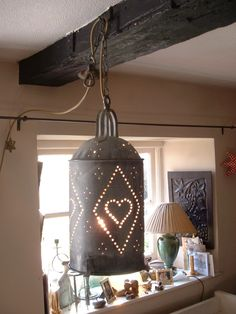 Salvaged, recycled, re-invented chicken drinker hanging lamp.