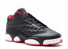 """Air Jordan 13 Low """"Bred"""" is one of the Air Jordan 13 Low releases set to launch this Summer 2015. Air Jordan 13 Low features a Black, University Red, Metallic Gold and White color scheme. Featuring a full Black tumbled leather upper with University Red interior, and outsole. Other details include a Metallic Gold Jumpman logo on the upper ankle and lace tips all while sitting atop a White midsole and Red outsole."""