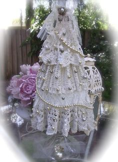 The Polka Dot Closet: Starched Doily Christmas Tree, No skill involved, just dip a doily in liquid starch and lay it over a styrofoam cone and you have A Shabby Romantic Christmas tree.